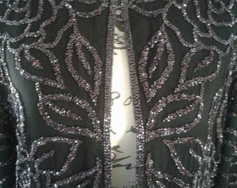 Sequined formal jacket....black with purple sequins......fully lined.....excellent condition...Creative creations.....Silk