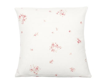 Faded floral cerise cushion on white oyster linen