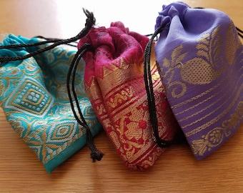 "Sari Bags. 3 1/2"" x 3"" drawstring 50p each!"