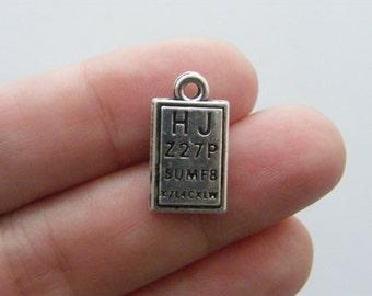 4 Eye test charms antique silver tone PT49