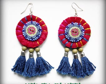 Red felt earrings and blue tassels