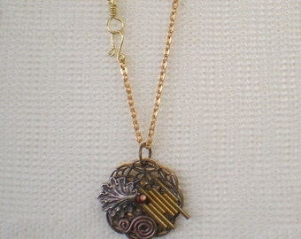 Mixed Metal Tubes and Antiqued Swirl Collage Assemblage Pendant