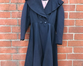 Exquisite Navy Coat with Unique Hood and Pink Camel Print Lining