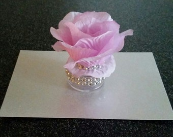 Beautiful rose - topped container. Perfect party favors for weddings, parties, & showers or use to store jewelry, mints, anything you like!