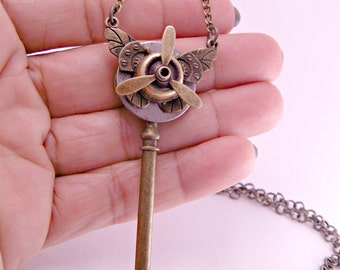 Steampunk Industrial Brass Skeleton Key with Butterly and Brass Airplane Propeller Steampunk with 20 Inch Chain