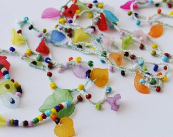 Colorful crocheted necklace, bracelet, belt with seed beads, leaves and flowers