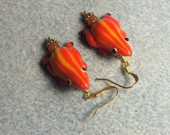 Orange with yellow stripes lampwork frog bead earrings adorned with orange Czech glass beads.
