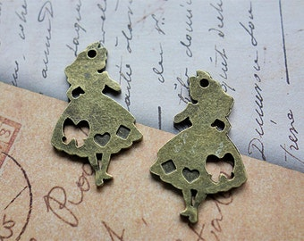 5 pieces Alice in Wonderland Alice charms - Antique bronze