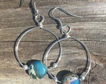 Silver hoops with blue stones