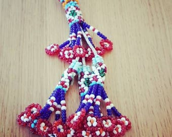 Borlon Kuchi of different color beads