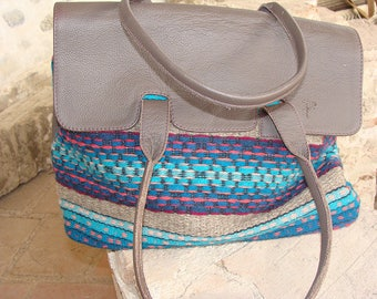 Handbag made of handwoven wool textile and brown textured high quality calf leather