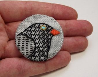Merle Birdseeker lin Badge