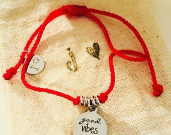 Good vibes only red bracelet.