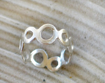 Sterling silver ring with small scraggly circles