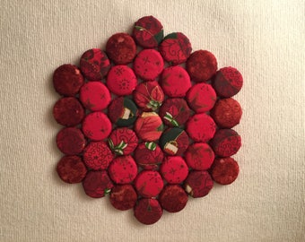 Hexagonal Kitchen Trivet with Shades of Red Design