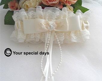 Wedding Garter, Ivory, cream embroidered bow,  pearls ribbons, crystal