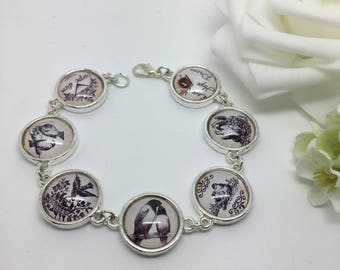 Carpe Diem. Seize the day - glass picture bracelet with bird images.