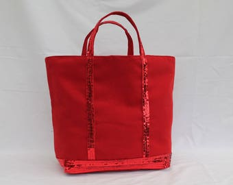 The cherry red bag with round sequins