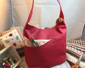 Pink faux ostrich leather handbag