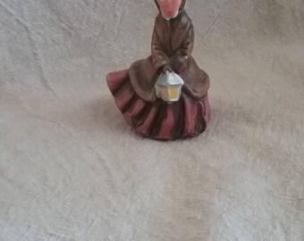 Christmas figure. Lady with Lantern