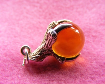 I) Vintage Sterling Silver Charm Dragons Claw holding an Amber coloured glass Orb