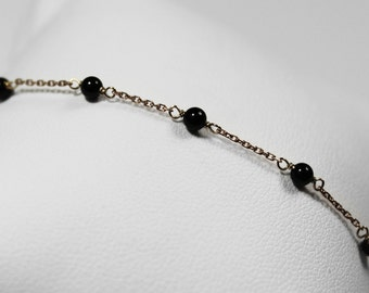 Rose gold and onyx beads