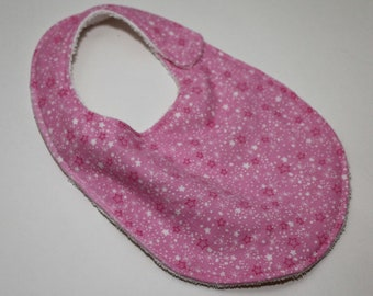 Sun, Moon, & Stars Pink Stars flannel reversible baby bib with White terry cloth