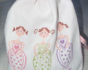 Embroidered pink pouch