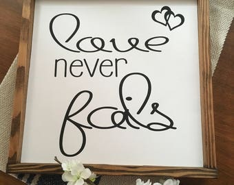 "Love never fails signs 13""x13"""