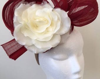 Red silk abaca fascinator with cream flower on a headband. Gorgeous on!