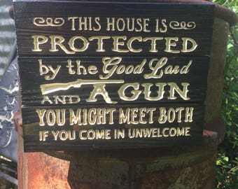 This House is Protected by the Good Lord and a Gun / carved wooden sign / FREE SHIPPING in the US