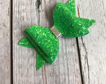 So green double stack glitter bow with metallic silver center
