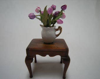 Miniature tulips in jug