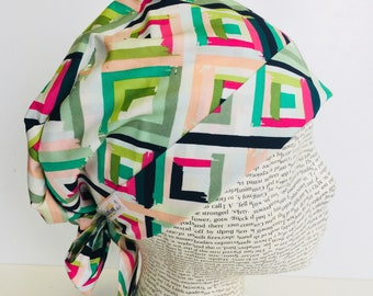 Tie Back Scrub Cap featuring a geometric pattern with greens pinks and blues
