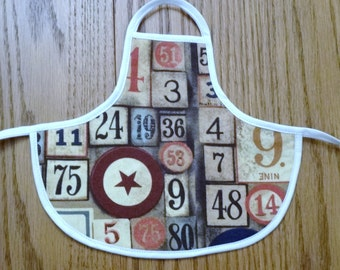 Bottle Apron in Game Pieces Print from The Farmer's Daughter