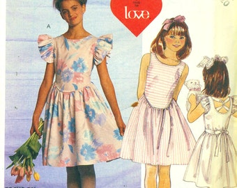McCall's 2995 Pullover Dress Back Scoop Neckline Crossed Ties Girl Size 7-8-10  ©1987