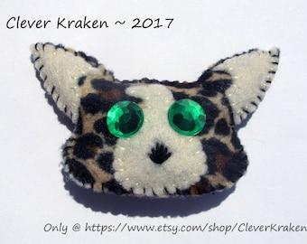 Leopard head animal barrette, black brown & beige felt, green plastic gem eyes, 3 inches on 2 inch French style barrette clip