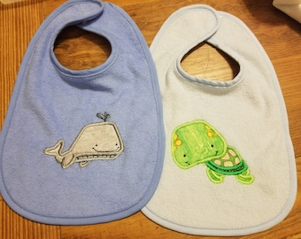 Two Pack of Whale and Turtle Bibs