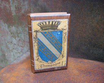 Champagne Book Box, vintage Reims heraldic wooden hinged container, shaped like a book. Wood carving decoration. Sparkling wine memento gift