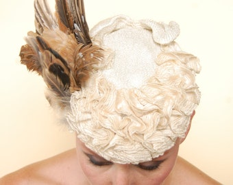 Frenchie: Taxidermy wing on Vintage Millinery Base