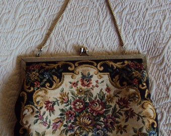 Floral  tapestry handbag with goldtone chain and clasp lined with black satin.