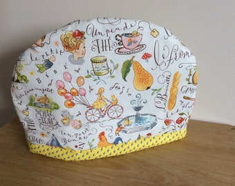 Hand made Fabric Tea Cozy in 'Paris' Fabric. Fits a 2 to 4 cup teapot. Keep your teapot warm!