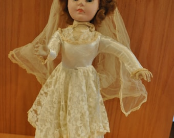 Vintage Doll Wearing Wedding Dress and Veil