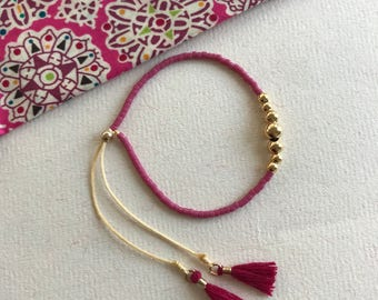 Pink tassel, gold filled beaded bracelet