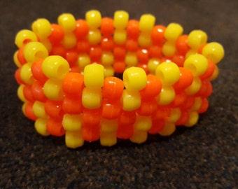 Yellow and orange kandi style beaded handmade bracelet