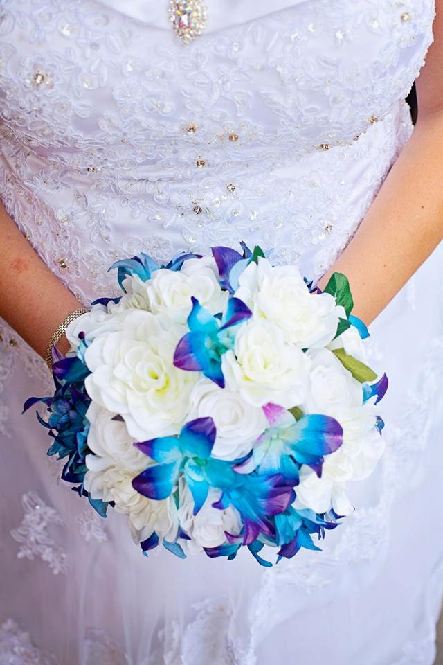 Bridal bouquet blue galaxy dendrobium orchids white roses