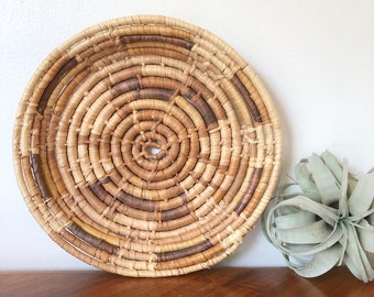 Woven coiled round handcrafted basket in browns / catch all / basket wall art / African style