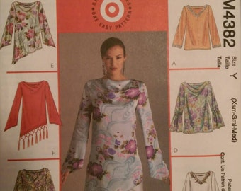 McCall's M4382. Misses'/Miss petite tops and tunics. 6 great looks, one easy pattern! Size XS, S, M. Pattern is new and uncut.