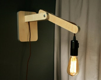 Wall lamp - also stands on the base as a bedside lamp or desk lamp. Edison bulb lamp. Birch plywood with metallic grey edge
