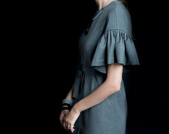 Grey dress with short folded sleeves and belt